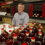 Bill Samuels signed bottles in the bottling room at Maker's Mark on Friday June 21, 2013 in Loretto, Ky
